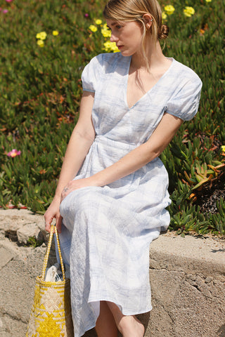 Cotton light blue and white windowpane plaid dress with puff sleeves, a tie at the waist, and of course side seam pockets | Love Faustine
