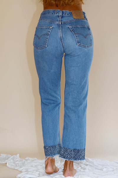 vintage levi's 501's cropped with indigo border printed  at hem