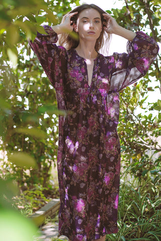 Sustainable dress with deep V-neckline, a kimono poet sleeve with elastic at the wrists midi length, and a sheered empire waist | Love Faustine