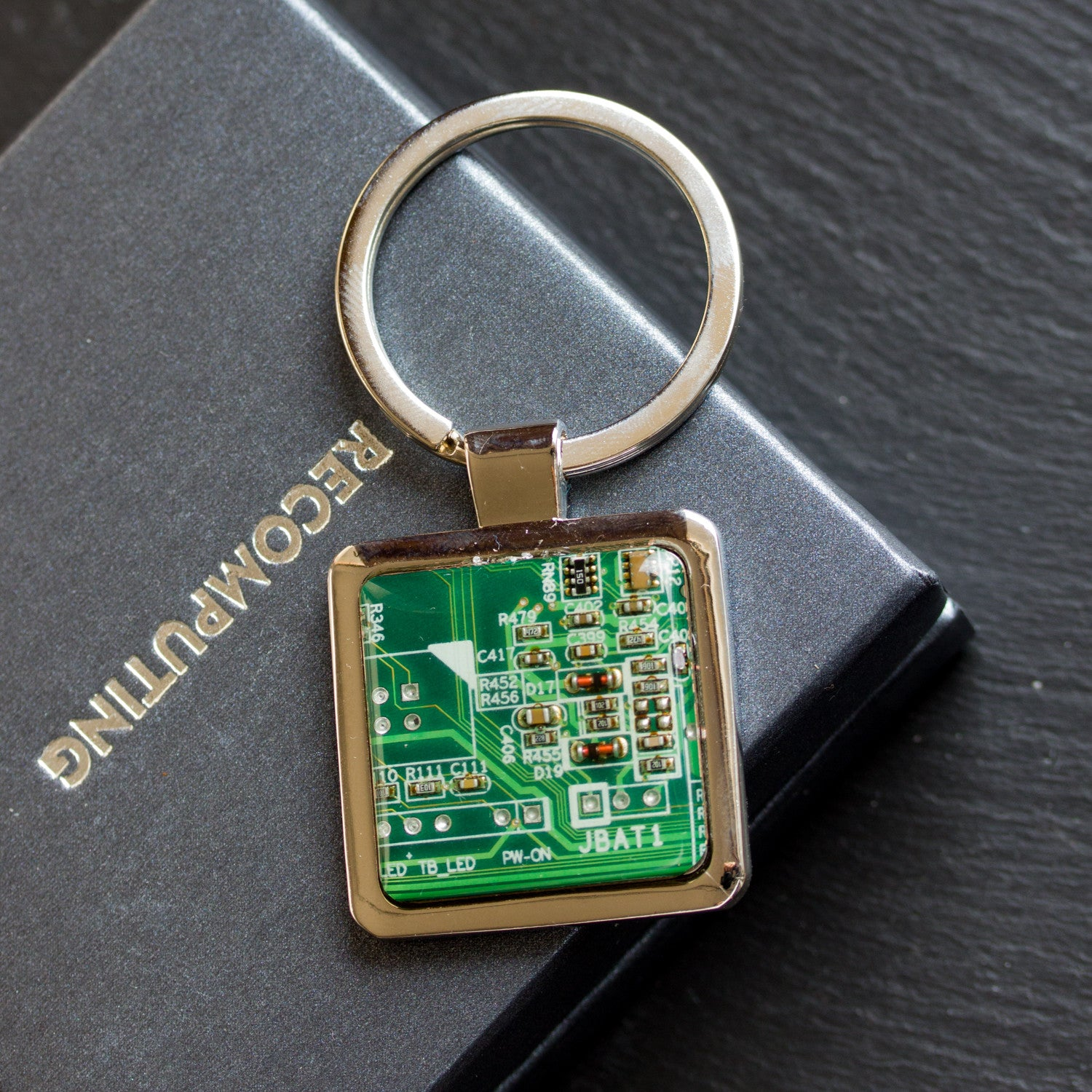 Unique keychain with circuit board piece