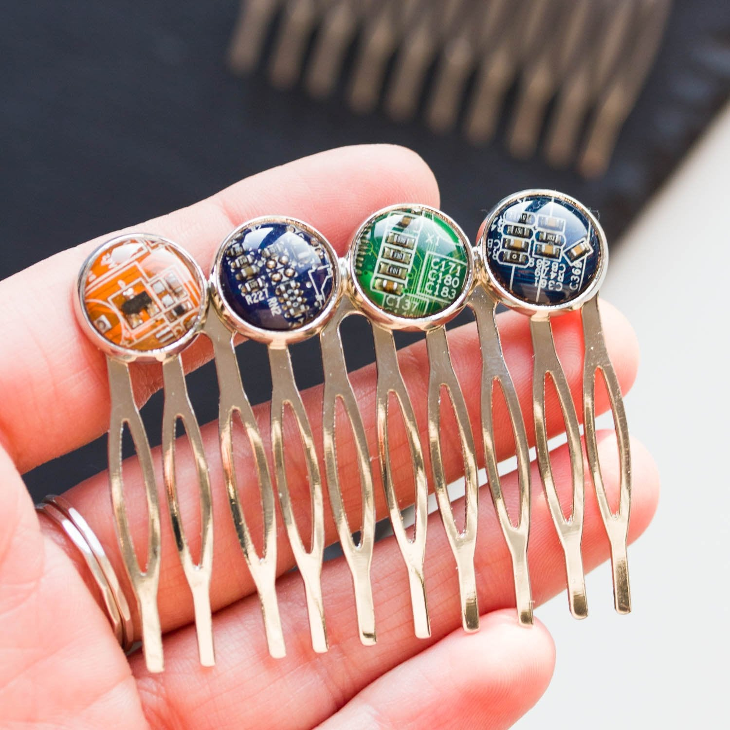 Colorful hair comb with four recycled circuit board pieces