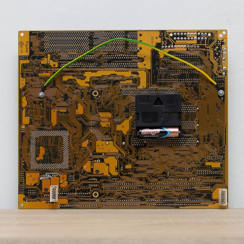 Techie Wall Clock made of yellow / olive green circuit board