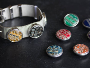 Bracelet with interchangeable circuit board button