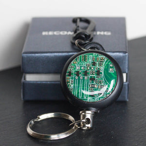 Retractable badge holder with a circuit board piece