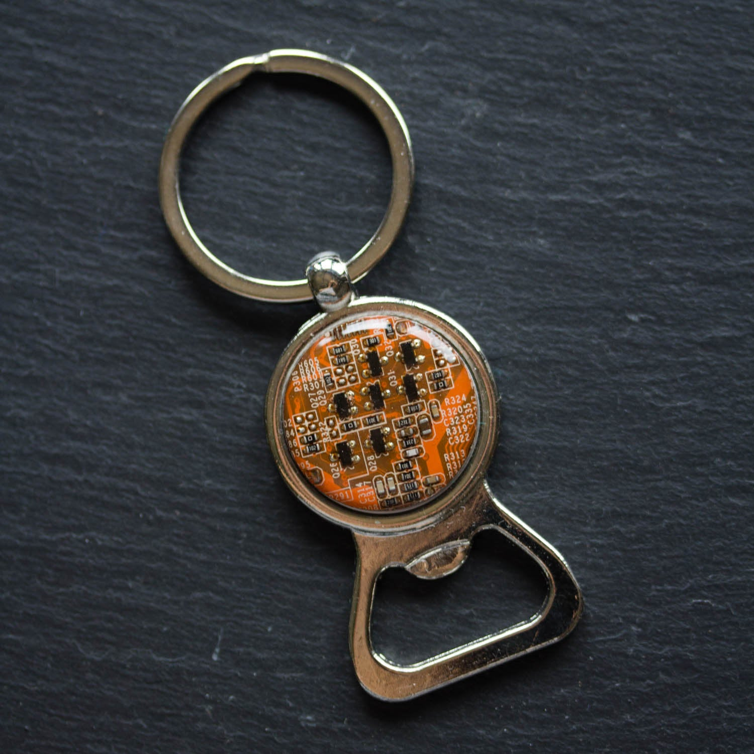 Bottle opener keychain with a circuit board