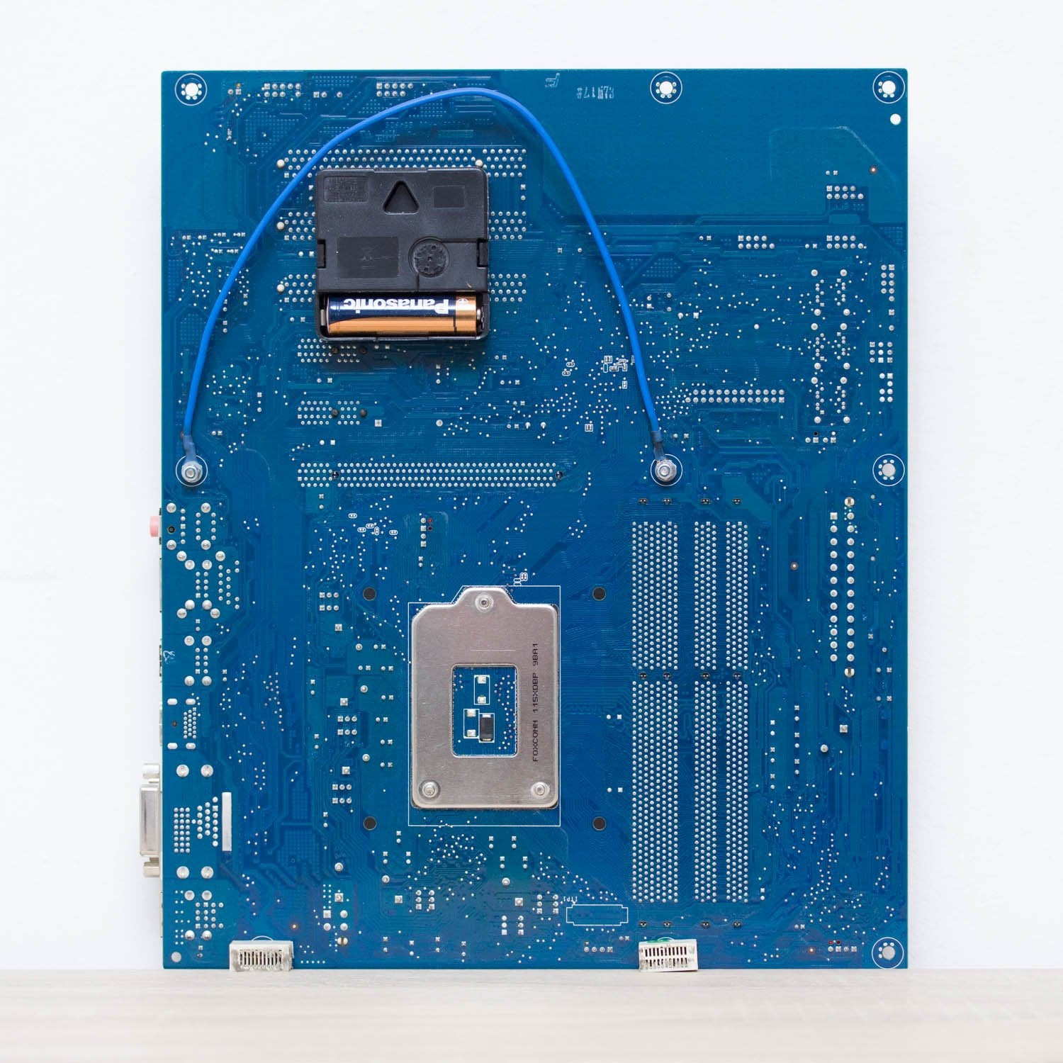 Wall Clock made of blue Circuit Board