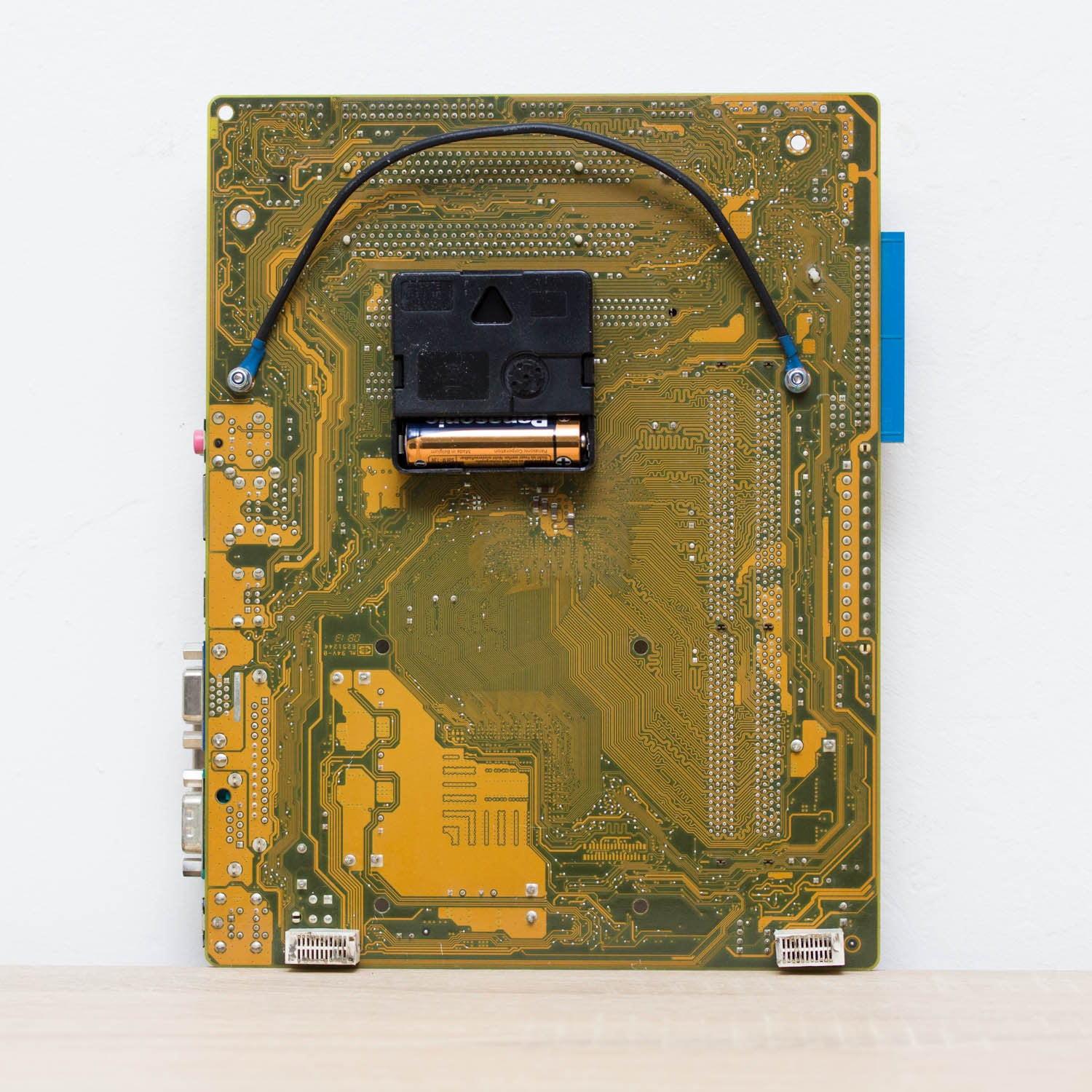 Geeky Wall Clock made of recycled yellow / olive green Circuit Board