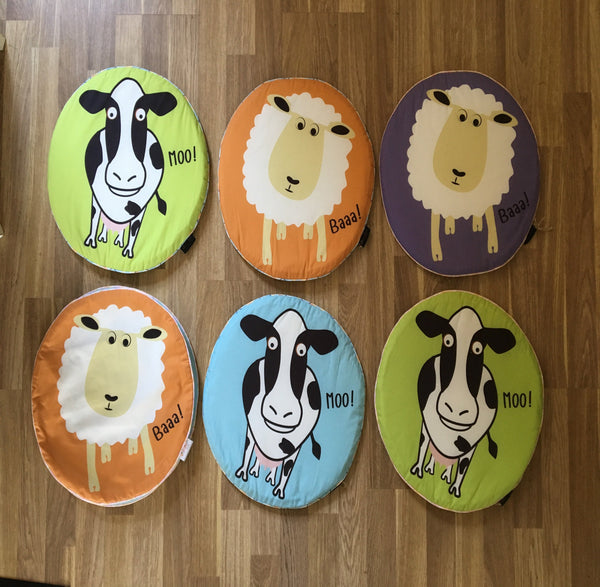 Floor seat pads for kids. Great for story time. Made from 100% cotton with sheep and cow images.