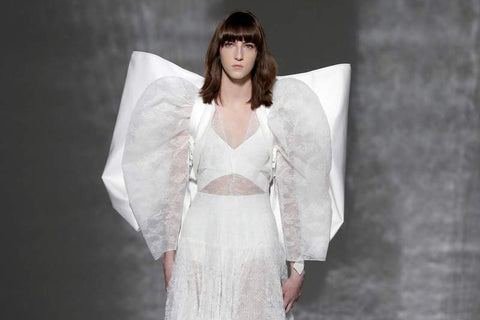 c63e43e9451 ... was the oversized backpack seen in Givenchy's show; the bag, complete  with a large bow addition, was designed by none other than Claire Waight  Keller, ...