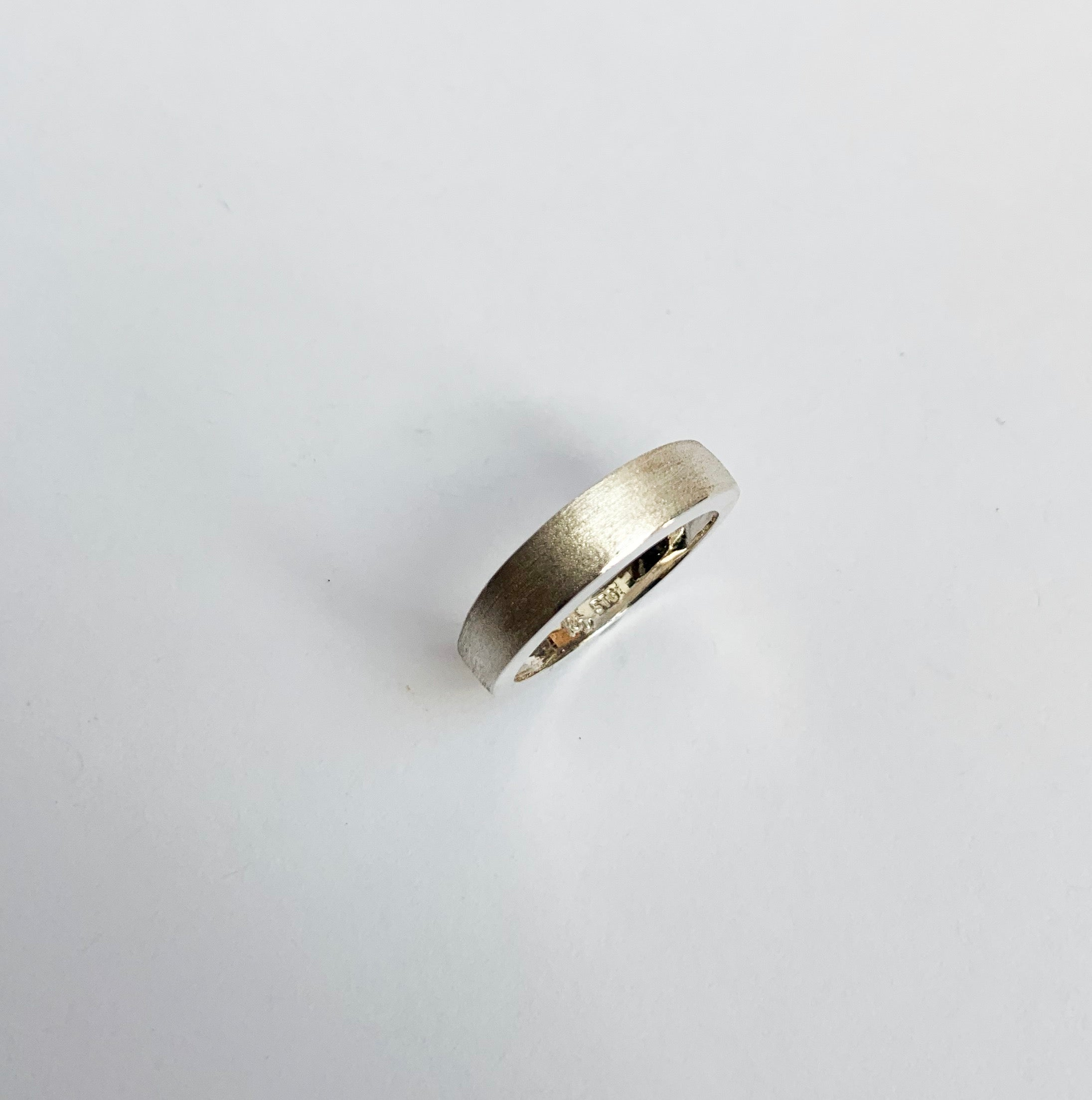 Off centre textured ring