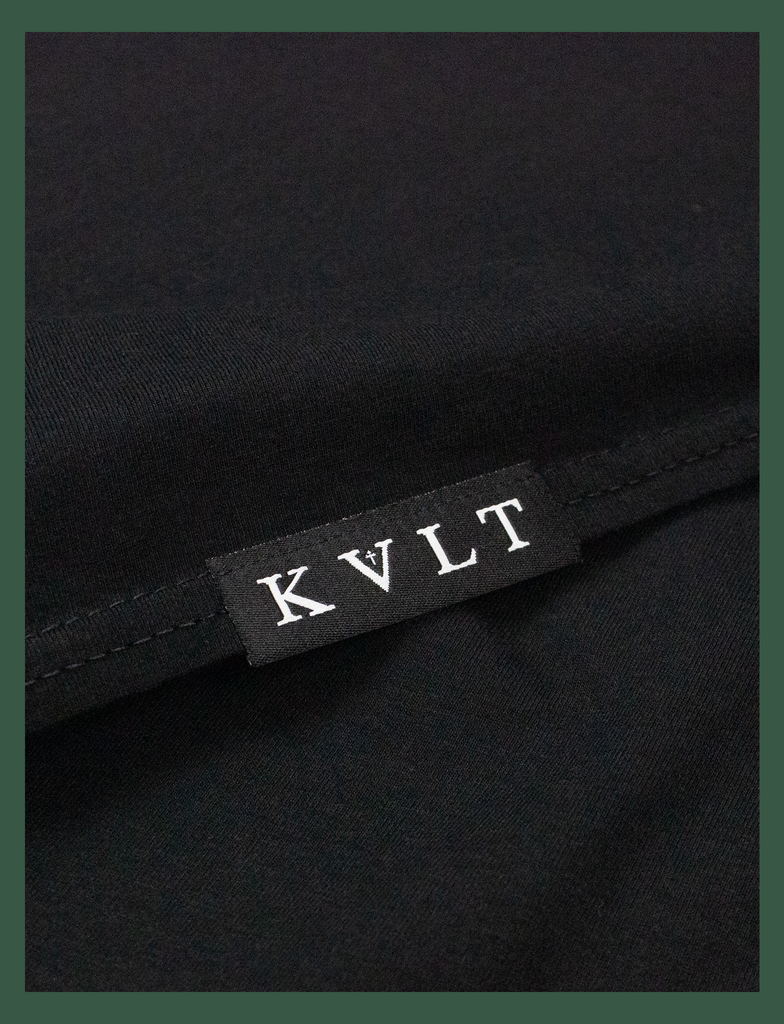 Close-up of the front of the woven hem label on the BLACK MINDS MATTER Charity Tee in Black by KULT Clothing | Please don't hesitate to love me. KULT