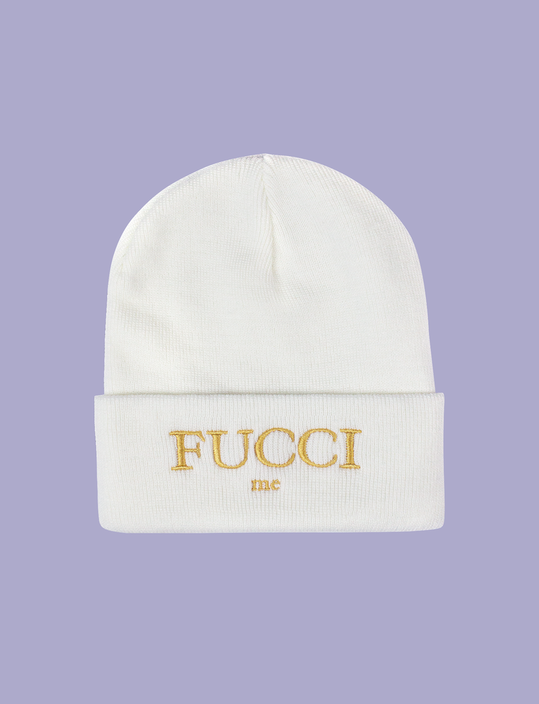 "Front of the FUCCI ME Beanie by KULT Clothing | ""Fucci Me"" embroidered design in gold thread on a white acrylic beanie hat"