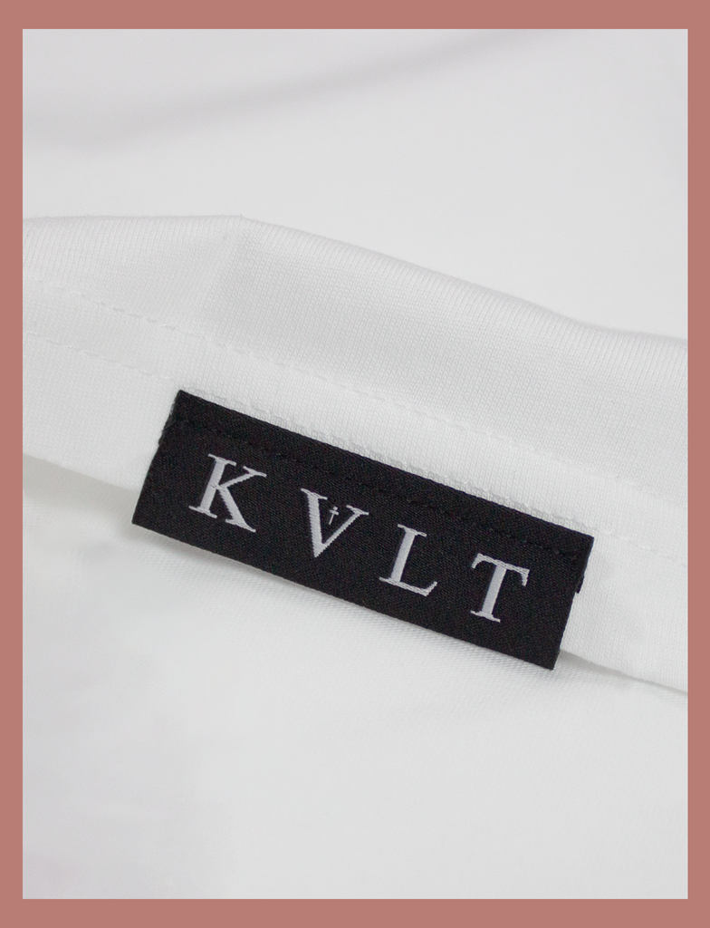 Close-up view of topside hem label on the IT WILL BE OK Longsleeve Tee by KULT Clothing | You are so valuable. No matter what you're going through right now, please know that you're needed. You are loved. It will be ok. KULT