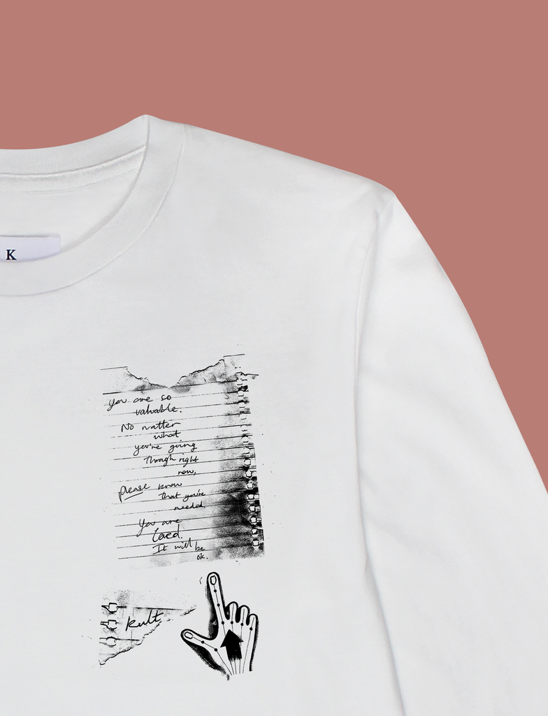 Close-up of the print on the IT WILL BE OK Longsleeve Tee by KULT Clothing | You are so valuable. No matter what you're going through right now, please know that you're needed. You are loved. It will be ok. KULT