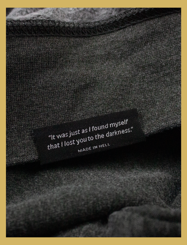 Close-up view of the underside hem label on the JOY Sweater by KULT Clothing | Aren't we all just doing stuff so we can get a hit of joy? What does it matter where you got that feeling, as long as it isn't hurting anyone else? Leave me be, I'm happy.