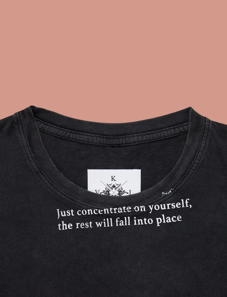 Close-up of the CONCENTRATE Tee in Sun-Bleached Black by KULT Clothing | eco-friendly, climate neutral t-shirt | Just concentrate on yourself, the rest will fall into place