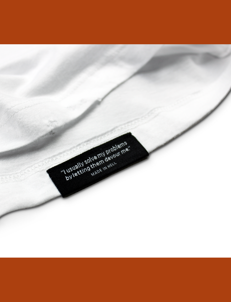 Close-up of the internal hem branding on the BASIK Tee in White