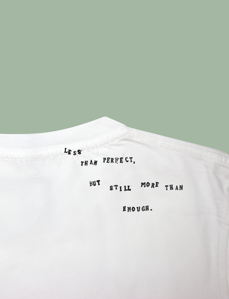 Reverse view of the I'M ENOUGH Tee in White by KULT Clothing | Less than perfect but still more than enough.