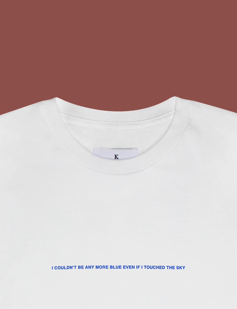 Close-up of the I'M BLUE Tee in White by KULT Clothing | I couldn't be more blue even if I touched the sky