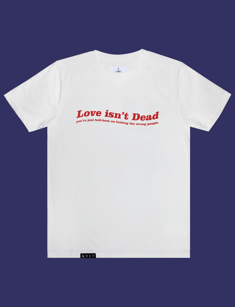 LOVE ISN'T DEAD Tee in White by KULT Clothing | eco-friendly, climate neutral t-shirt | Love isn't Dead you're just hell-bent on fucking the wrong people.