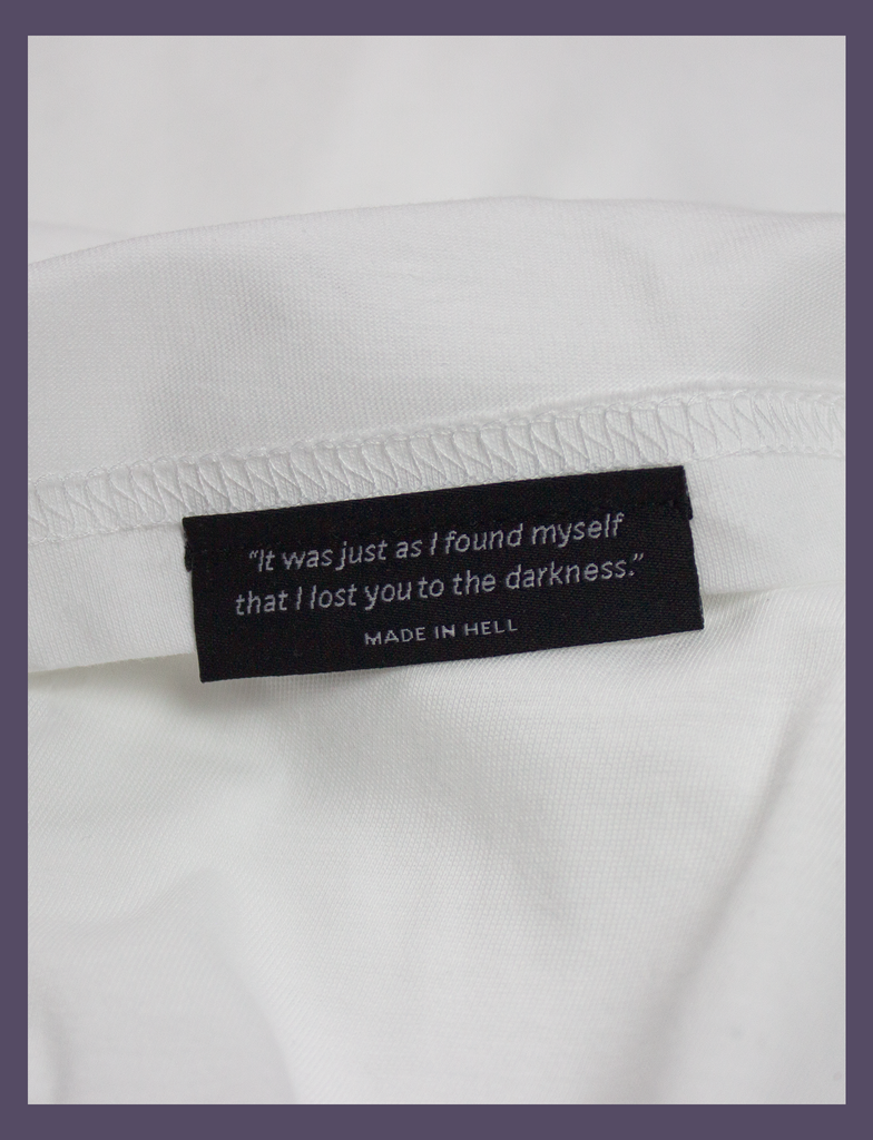 "Close-up of the underside hem label on the SMALL FEELINGS Tee by KULT Clothing | ""It was just as I found myself that I lost you to the darkness."" Made In Hell"