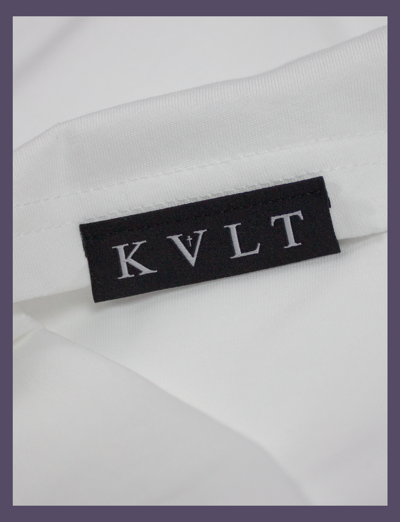 "Close-up of the top side hem label on the SOCIAL DISTANC Tee by KULT Clothing | ""It was just as I found myself that I lost you to the darkness."" Made In Hell"