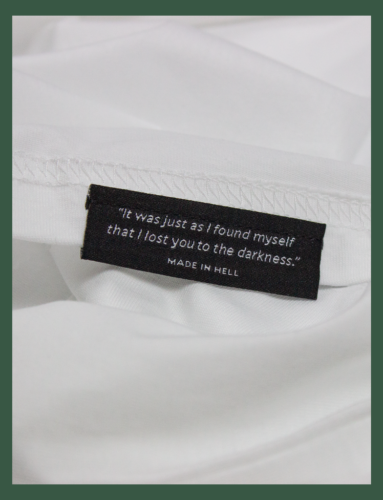 "Close-up of the underside hem label on the SOCIAL DISTANCING Tee by KULT Clothing | ""It was just as I found myself that I lost you to the darkness."" Made In Hell"