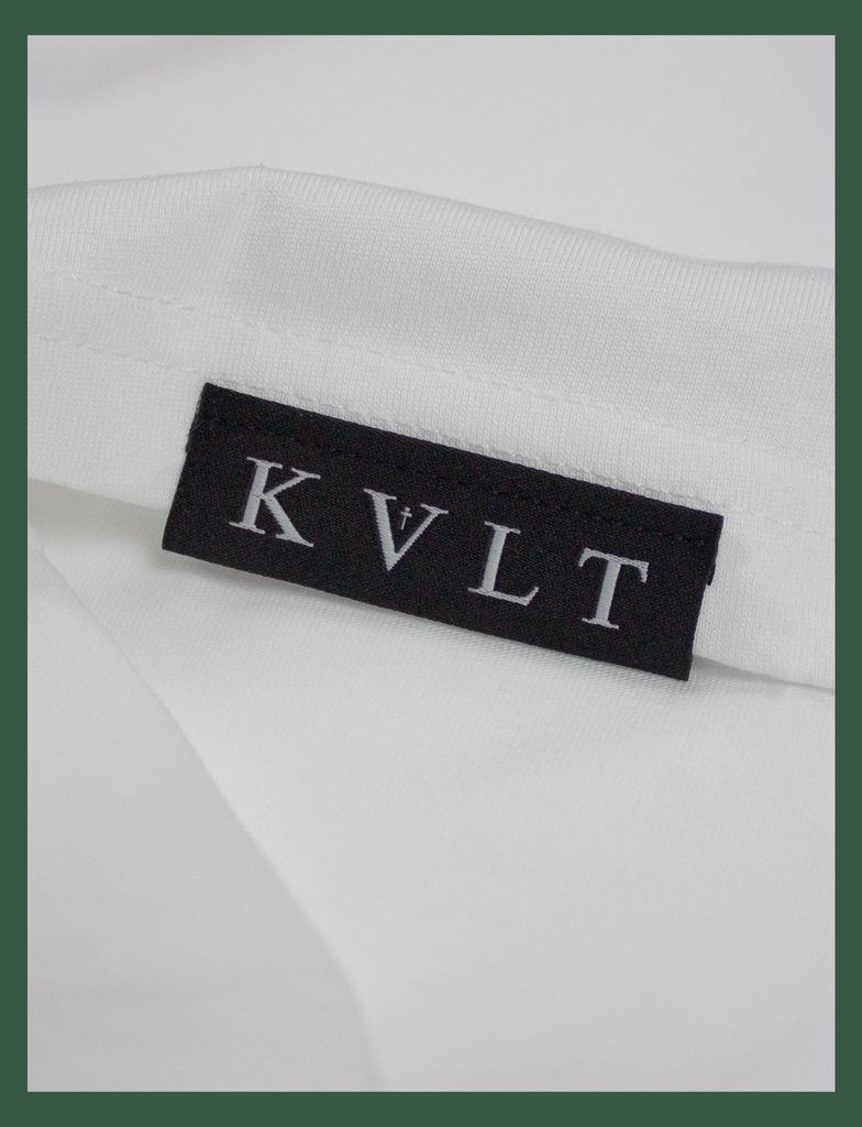 "Close-up of the top side hem label on the SOCIAL DISTANCING Tee by KULT Clothing | ""It was just as I found myself that I lost you to the darkness."" Made In Hell"