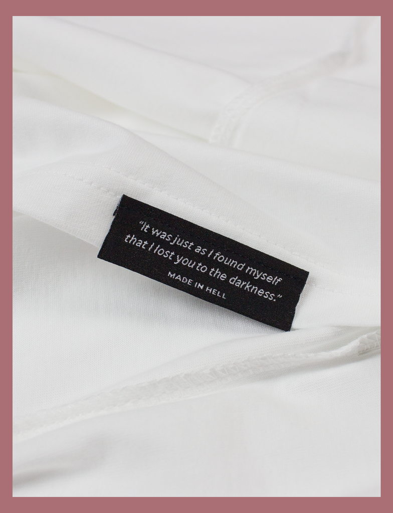 Close-up view of the underside hem label on the SUNSHINE Tee by KULT Clothing | Sunshine on my skin, I feel me again.
