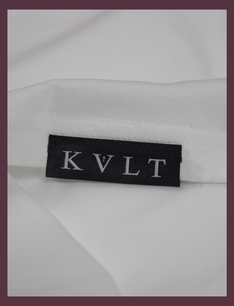 Close-up of the top side hem label on the SUNSHINE Tee by KULT Clothing | You Should Take A Moment To Stop And Look Around Every Once In A While. There's Some Awful Shit Going On. KULT