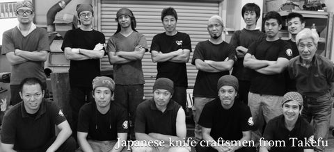 Photo of several bladesmiths and knife makers from Takefu, Japan lined up and posing for the camera.