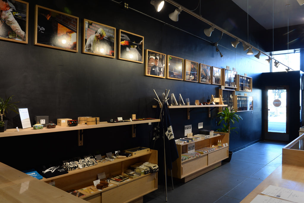A photo of the Seisuke Knife Portland shop interior, specifically of shelves displaying knife accessories.