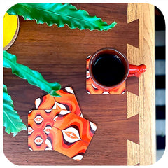 70s Op Art Coasters on vintage table with vintage mug and house plant - birdseye vew