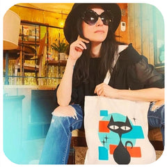 Atomic Cat Tote Bag modelled by retro model