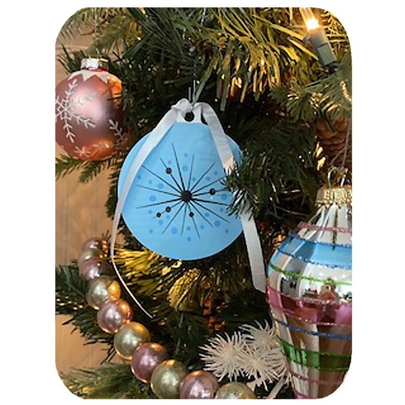 files/Atomic-Christmas-Decoration-blue-on-tree-with-frame.jpg