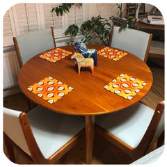Customer photo - 70s Orange Op Art Placemats on Gplan table with chairs | The Inkabilly Emporium