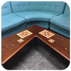 Customer photo - Orange Op Art Placemats and coasters on vintage mid century coffee table next to vintage blue sofa | The Inkabilly Emporium
