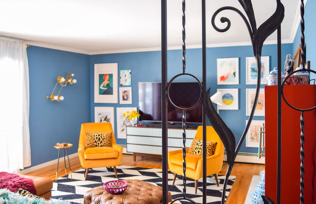 House Tour: Ariel's bold retro home - Lounge wide shot through railings.Photo credit PMQforTWO