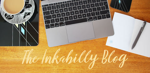 The Inkabilly Blog header image: the inkabilly blog workstation with laptop, notebook & pen and cup of tea