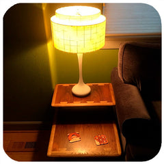 Customer photo - Op Art Coasters on vintage coffee table with vintage lamp | The Inkabilly Emporium