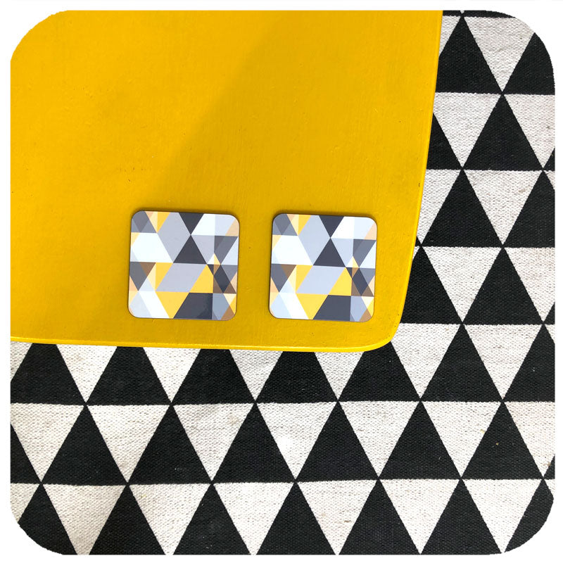 files/scandi-geometric-coasters-on-yellow-table.jpg