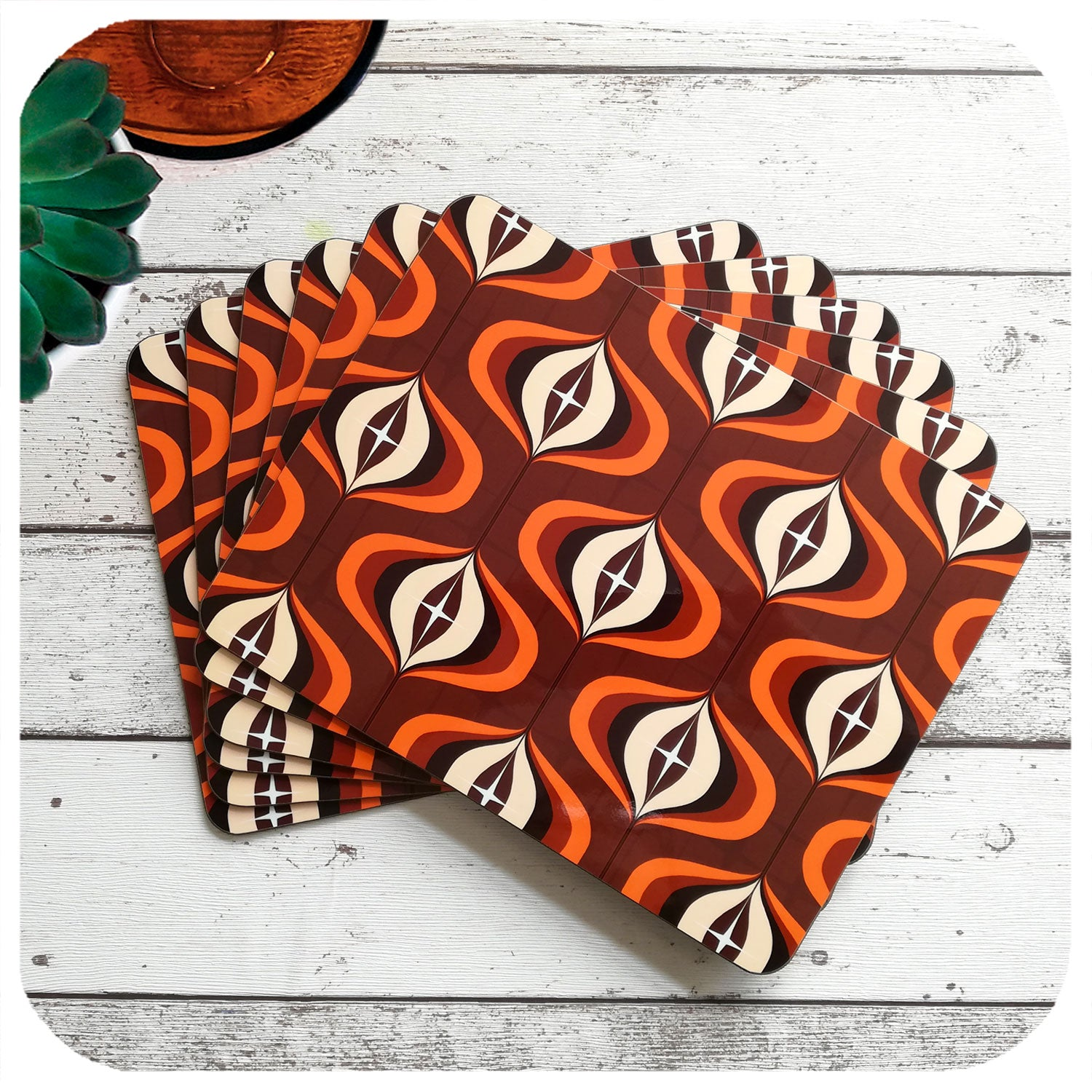1970s Op Art Placemats in Brown and Orange, set of 6 laid out in a fan | The Inkabilly Emporium