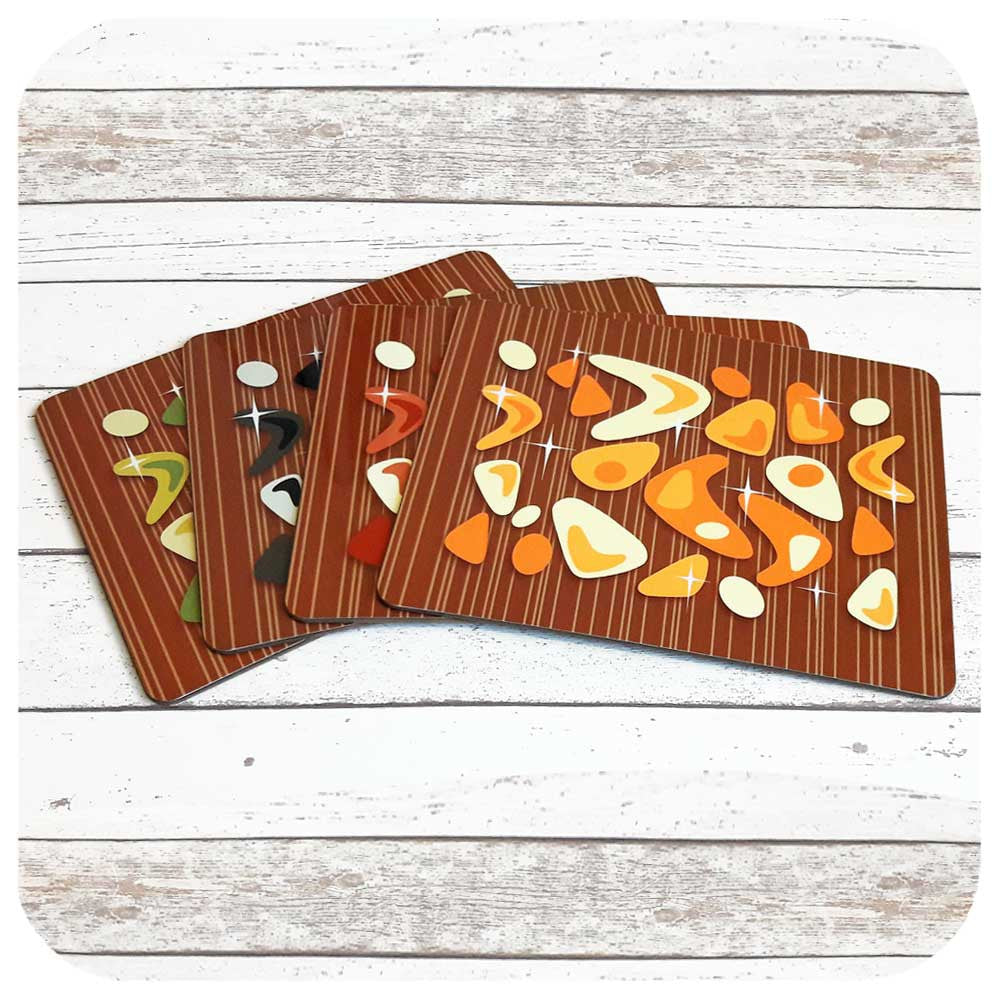 Atomic Boomerang Placemats on Teak  | The Inkabilly Emporium
