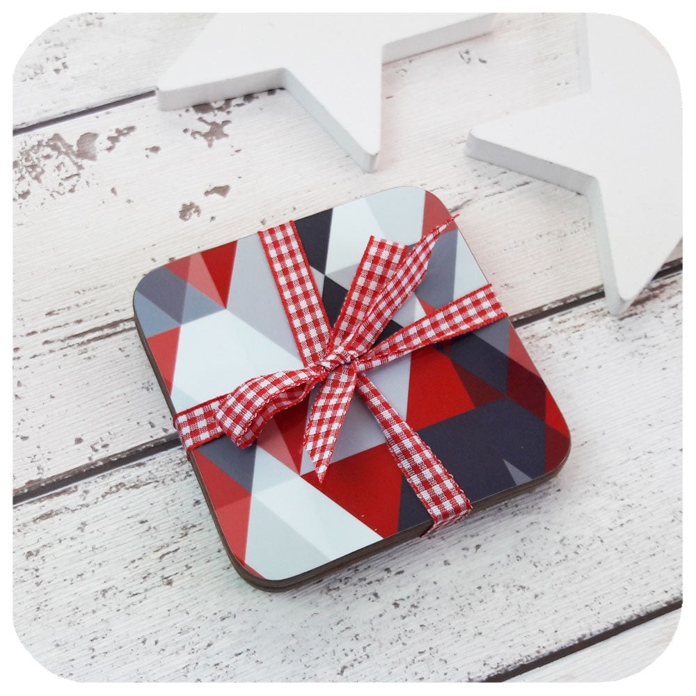 Scandi Coaster set in ruby reds and greys, wrapped in ribbon | The Inkabilly Emporium