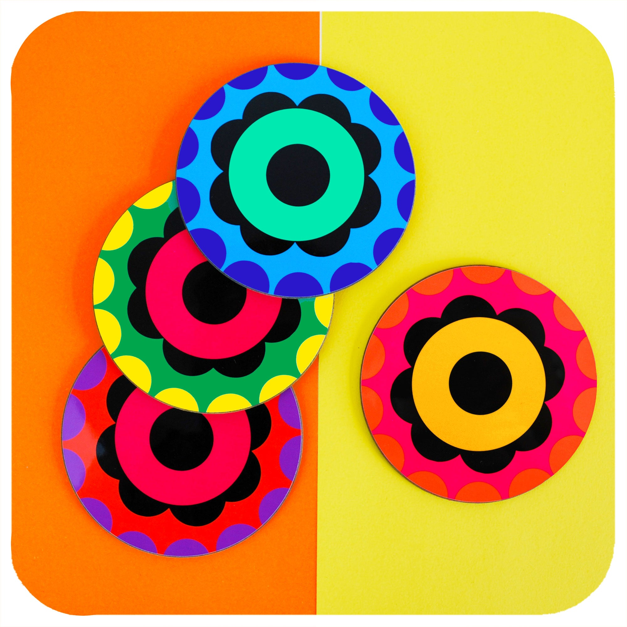 Set of 4 Colourful 60s Flower Power style coasters scattered on a colourblock background | The Inkabilly Emporium