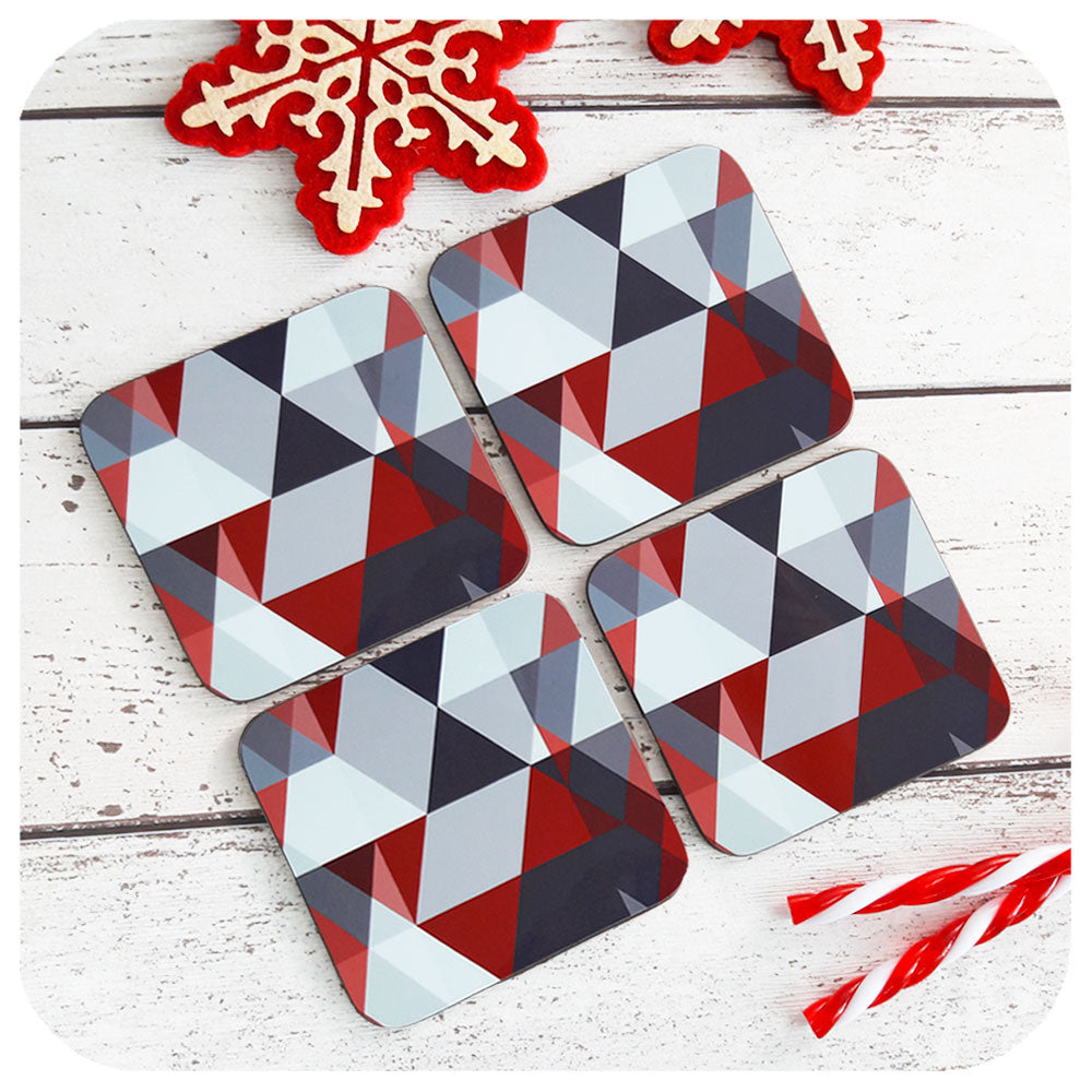 Scandi Geometric Coasters in Grey & Red, set of four, on table with Christmas decor | The Inkabilly Emporium