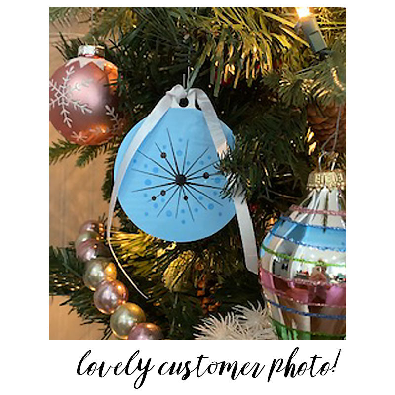 Customer Photo of our Atomic Style Christmas Tree Decoration in Pastel Blue, hanging on a Christmas Tree | The Inkabilly Emporium