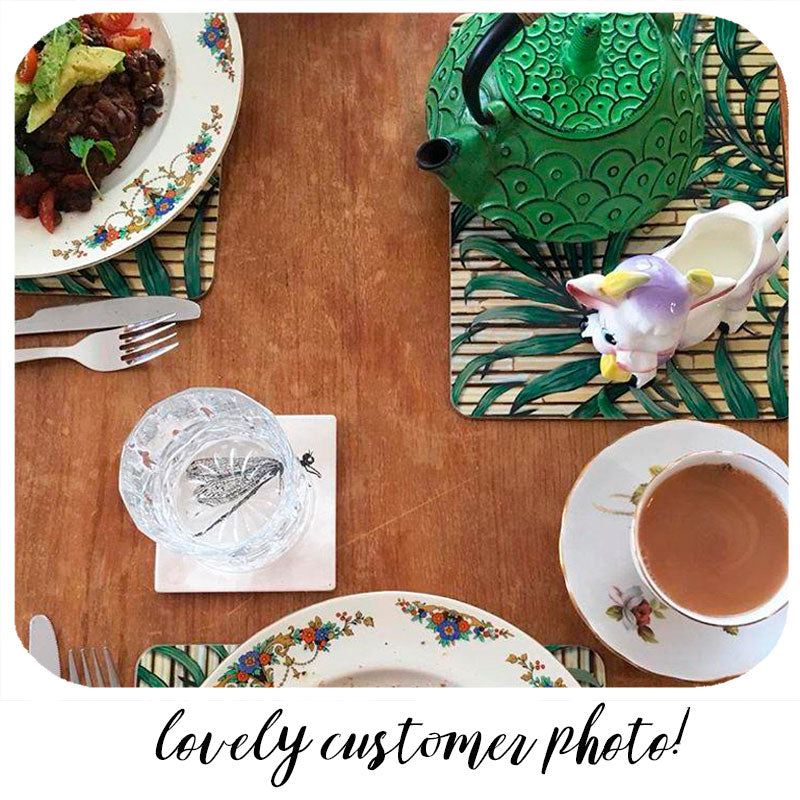Fabulous customer photo of our Tropical Palm Leaf Placemats on her eclectic style table | The Inkabilly Emporium