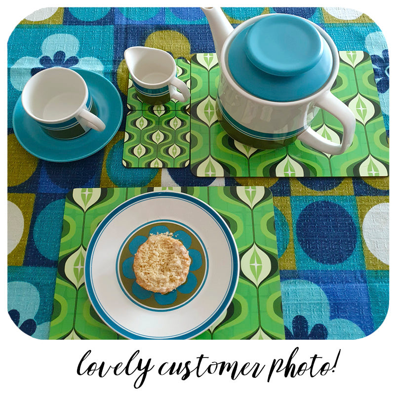 Green Op Art placemats and coasters on a 70s table cloth with vintage crockery