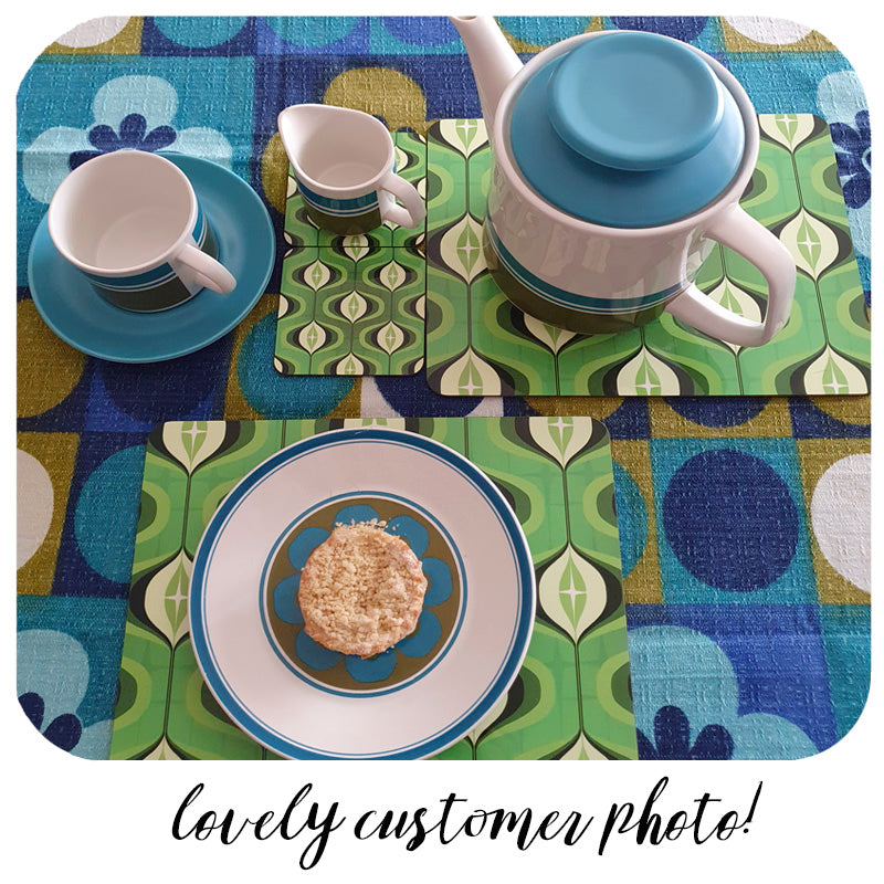 Green Op Art placemats and coasters on a 70s table cloth with vintage crockery - photo  by customer